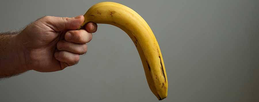 A hand holding a banana