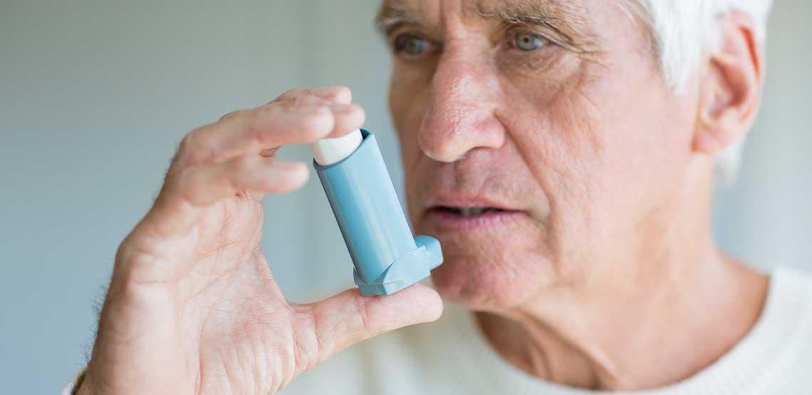 A person using an inhaler.