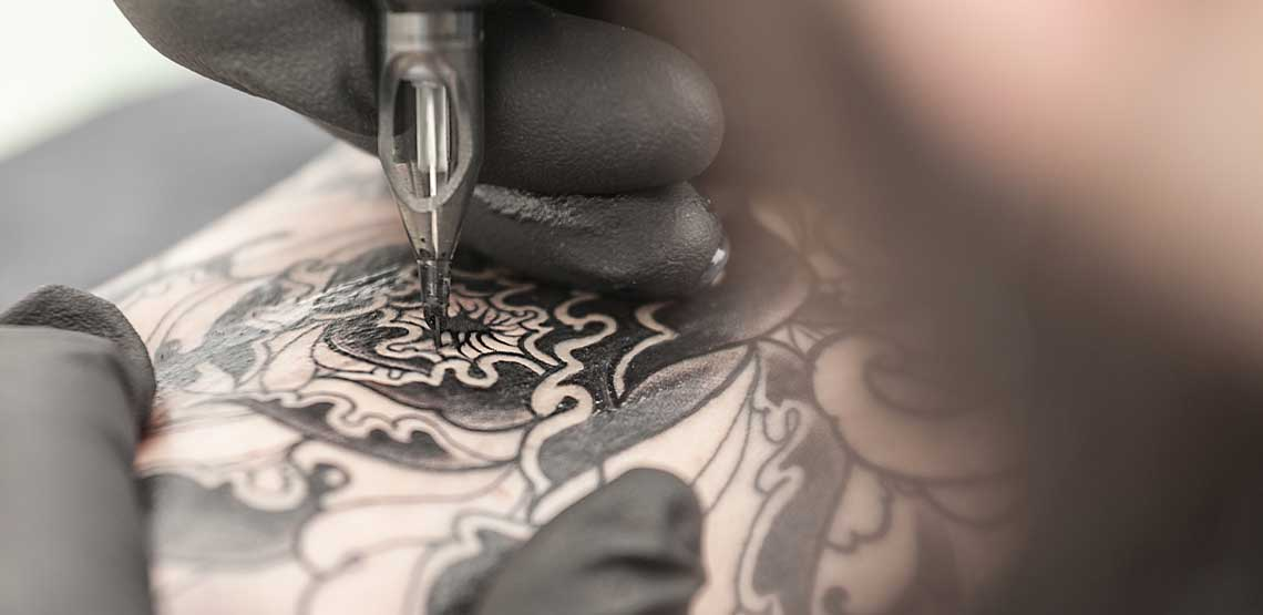 A tattoo being filled in.