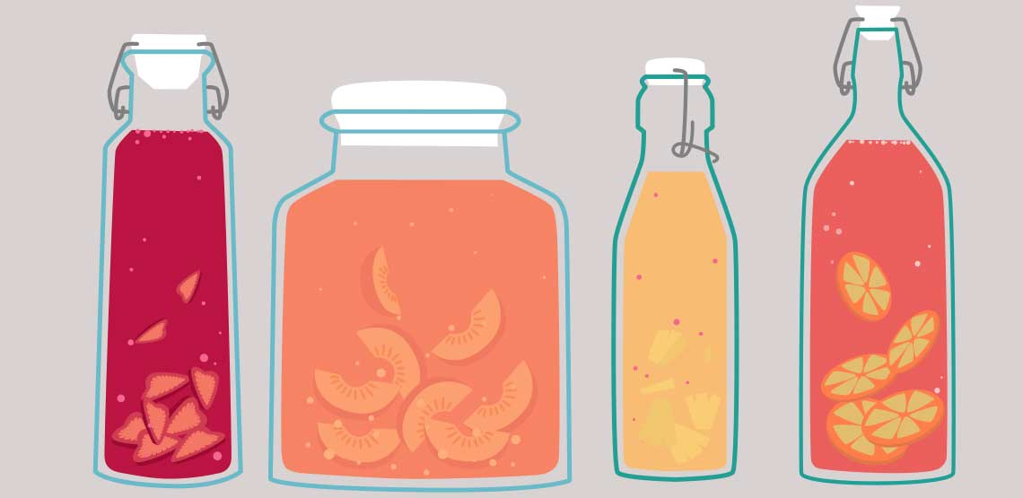 A drawing of four different kombucha bottles, all containing fruit
